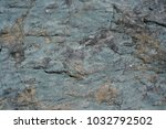 Small photo of Natural gray stony inhomogeneous uneven grunge background.
