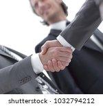 closeup.handshake of business... | Shutterstock . vector #1032794212
