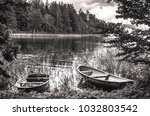 Rowing Boats By A Forest Lake...