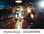 alcoholic sitting at bar and... | Shutterstock . vector #1032805096