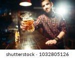 man holds glass of beer  guy at ... | Shutterstock . vector #1032805126