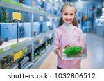 little girl with plant for... | Shutterstock . vector #1032806512