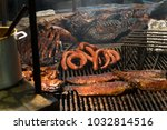 Small photo of Texas style bbq pit smoked meats ribs sauce over wood flame