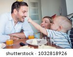 happy family.father  mother and ... | Shutterstock . vector #1032818926