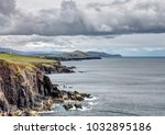 moody irish sea with cliffs and ... | Shutterstock . vector #1032895186