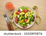 fresh salad with avocado and...   Shutterstock . vector #1032895876