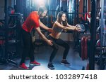 personal trainer helps the girl ... | Shutterstock . vector #1032897418