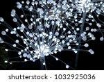 spray of festive lights at night | Shutterstock . vector #1032925036
