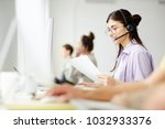 young operator with headset... | Shutterstock . vector #1032933376