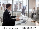 young businessman siting in... | Shutterstock . vector #1032933502