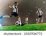 team of intercultural boys... | Shutterstock . vector #1032936772