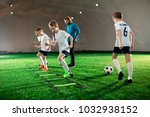 youthful kids in uniform... | Shutterstock . vector #1032938152