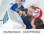 air conditioning technician and ... | Shutterstock . vector #1032950362