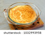 omelet with golden crust for a... | Shutterstock . vector #1032993958