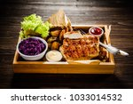 grilled chicken fillet and... | Shutterstock . vector #1033014532