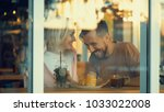 happy young couple behind the... | Shutterstock . vector #1033022008