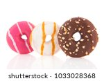 three donuts in pink  white and ... | Shutterstock . vector #1033028368