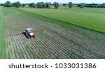 Small photo of Aerial photo corn field tractor spraying agrochemical or agrichemical over young maize field in most cases agrichemical refers to pesticides like insecticides herbicides fungicides and nematicides