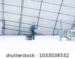 motion blurred traveller... | Shutterstock . vector #1033038532