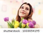 attractive woman arranging...   Shutterstock . vector #1033054195