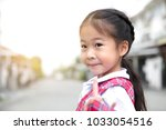 cute asian little girl in... | Shutterstock . vector #1033054516