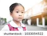 cute asian little girl in... | Shutterstock . vector #1033054522