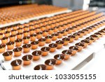 production of pralines in a... | Shutterstock . vector #1033055155