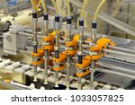 production of pralines in a... | Shutterstock . vector #1033057825