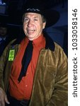 Small photo of Los Angeles, California - exact date unknown - circa 1990 - late country singer Buck Owens arriving at a celebrity event