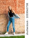 fashion girl standing near... | Shutterstock . vector #1033063738