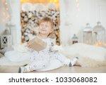 beautiful baby girl near a... | Shutterstock . vector #1033068082