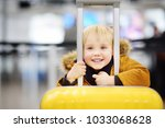 cute happy little boy with big... | Shutterstock . vector #1033068628