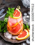grapefruit and fresh mint... | Shutterstock . vector #1033079512