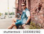 portrait of a trendy young man... | Shutterstock . vector #1033081582