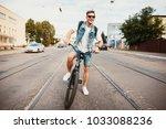 handsome hipster enjoying city...   Shutterstock . vector #1033088236