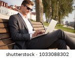 young business man outdoors... | Shutterstock . vector #1033088302