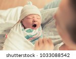 mother holding cute newborn... | Shutterstock . vector #1033088542
