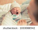 mother holding cute newborn... | Shutterstock . vector #1033088542