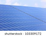 Solar panel and clouds - stock photo