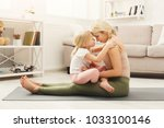 happy mother and little... | Shutterstock . vector #1033100146