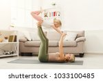 young woman and little girl... | Shutterstock . vector #1033100485