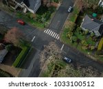 aerial shot of a four way... | Shutterstock . vector #1033100512