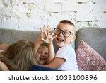 action shot of caucasian kids... | Shutterstock . vector #1033100896