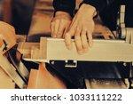 a carpenter works on... | Shutterstock . vector #1033111222