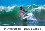 riding the waves. costa rica ... | Shutterstock . vector #1033163596