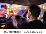 male driver ride a car during... | Shutterstock . vector #1033167238