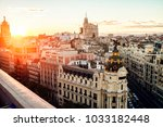 cityscape of madrid at sunset ... | Shutterstock . vector #1033182448