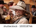 old cowboy holding whiskey... | Shutterstock . vector #103318766