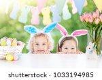 family easter morning. children ...   Shutterstock . vector #1033194985
