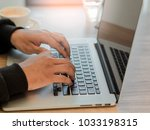 working at home with laptop man ... | Shutterstock . vector #1033198315
